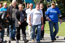 Grey District mayor Tony Kokshoorn and Spring Creek union delegate Trevor Bolderson lead the delegation of coal miners onto Parliament Grounds today. Photo / Mark Mitchell