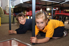 At Spreydon School's new entrant class, Mihana Hof (5) and Chloe Palmer (6) practice the Drop, Cover and Hold drill. Photo / NZ Herald