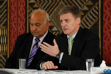 Bill English (right, with kaumatua Hemana Eruera) says asset sales would lessen state borrowing. Picture / Christine Cornege 