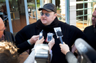 Kim Dotcom speaks to the media outside the High Court. Photo / Sarah Ivey