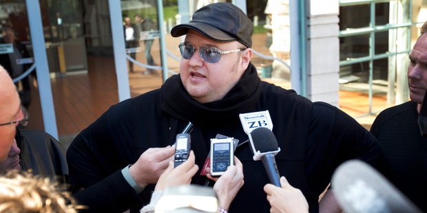 Kim Dotcom speaks to the media outside the High Court at Auckland yesterday afternoon. Photo / Sarah Ivey