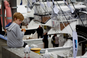 Dillon Mulgrew is wary of the seagulls looking for food as he eats his lunch at the boat show yesterday.  Photo / Sarah Ivey