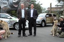 Zoo keeper Anneke Haworth with Anubis, Auckland Zoo director Jonathan Wilcken and Glenn Harris of Mazda.