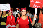 Tunisian women carry placards protesting their rights which read: 'no future for Tunisia without women' and right, 'equal rights for men and women'. Photo / AP