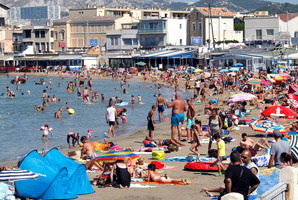 People bathe at Pointe Rouge in Marseille, a world away from the voilent northern suburbs. Photo / AP