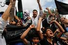 Kashmiri Muslims shout slogans during a protest in Srinagar, India. Photo / AP