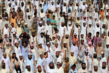 Supporters of Pakistani religious group Ahle Sunnat Wal Jammat shout anti-US slogans during a funeral for a colleague who was killed in Friday's violent protest against an anti-Islam film. Photo / AP