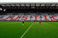 Fans create a crowd mosaic displaying the word 'justice' during the English Premier League soccer match between Liverpool and Manchester United. Photo / AP