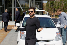 Google co-founder Sergey Brin with a self-driving Prius (and right) on the day California law was changed to allow 'autonomous vehicles'.  Photo / Eric Risberg