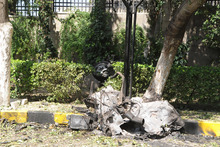 A damaged car is seen near Syria's army command headquarters in Damascus, Syria. Photo / AP