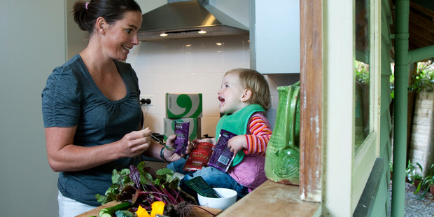 Charlotte Rebbeck, managing director of Green Monkey, organic baby food producer, with daughter Eve. File photo / Simon Baker