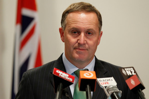 John Key clearly feels uncomfortable about the week's events, which top the scandal where an SIS briefcase containing a Penthouse and some pies was found in the street. Photo / Mark Mitchell