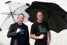 Madeblunt managing director, Scott Kington (left) and designer Greig Brebner with their Blunt umbrellas, made near Xiamen, China. Photo / NZ Herald