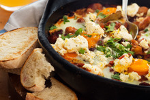 Baked eggs and chilli beans with creamed lemon feta. Photo / Babiche Martens
