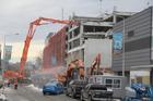 Demolition of a building on Lichfield Street near Colombo Street. Photo / Geoff Sloan