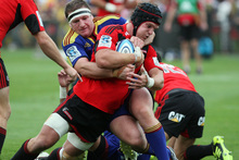 Matt Todd in the tackle of Highlander's Chris King. Photo / NZPA