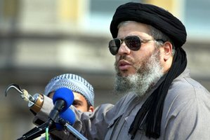 Radical muslim clerk Sheikh Abu Hamza gestures while addressing devotees at the 'Rally for Islam' at Trafalgar Square in central London. File Photo / AP