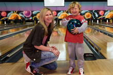 Rachel Grunwell and her son, Lachlan Buckley, 5, swap bowling tips at Pins Lincoln in Henderson. Photo / Getty Images