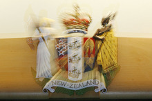 The Auckland woman was charged with assaulting two children with a wooden spoon.
