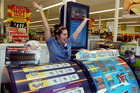 Jodie Pothoven, Lotto assistant at Countdown Carlyle, Napier, shows her delight after the store sold a winning $2 million first division Lotto ticket. Photo / Duncan Brown