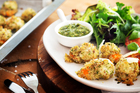 Crumbed scallops with grilled tomatoes and salsa verde. Photo / Babiche Martens
