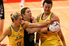 Irene van Dyk (C) of New Zealand fights for the ball during the Constellation Cup match between the New Zealand Silver Ferns and the Australian Diamonds. Photo / Getty Images.