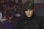 John Galliano's menswear fashion collection was this season inspired by bad boys of prohibition America. In the depths of an old warehouse in the 15th arrondissement in Paris, a fall/winter 12/13 version of Al Capone walks the runway in oversized double-breasted suits and black varnished trench coats belted at the waist.