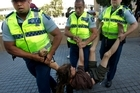An Occupy Auckland protester is arrested by Police after he tried to claim back his tent and gear. Photo / Brett Phibbs