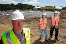 Foodstuffs' Tony Catton, site manager Graham Bayes and Mark Sigglekow of Pragmatix on the new Silverdale Pak'nSave site. Photo / Steven McNicholl