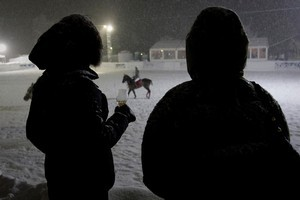 Patrons watch the annual Klosters Snow Polo event in Klosters, Switzerland. Photo / Bloomberg