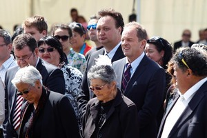 Labour leader David Shearer and deputy leader Grant Robertson, left, and MP Rino Tirikatene are escorted onto the Ratana Pa Marae. Photo / Mark Mitchell