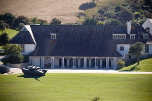 Kim Dotcom, who is facing extradition over copyright breaches, has a new acquisition at his Coatesville house - an inflatable tank. Photo / Dean Purcell