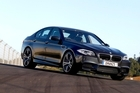 Visual cues, like the four muffler outlets, point to the new BMW M5's mighty performance. Photo / Simon Watts