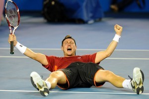 Australia's Lleyton Hewitt falls to the court as he celebrates his win over Canada's Milos Raonic in their third round match at the Australian Open tennis championship, in Melbourne, Australia. Photo / AP