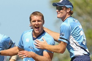 Michael Bates (L) joins Auckland teammate Martin Guptill (R) in the one-day and Twenty20 squads. Photo / Getty Images