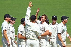 Doug Bracewell of New Zealand is congratulated on the wicket of Malcolm Waller of Zimbabwe. Photo / Getty Images