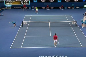 A ball boy catches a ball hit to him by Roger Federer. Photo / YouTube