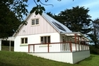 The Craw Homestead is solar-powered, has a shower and sleeps up to six. Photo / Supplied