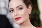 Angelina Jolie reportedly snubbed Stacy Keibler on a recent flight. Photo / AP