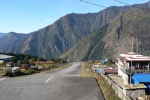 Landing or taking off from Lukla Airport in Nepal is a nail-biting experience, with a cliff at the end of the runway. Photo / Jim Eagles