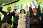 36-year-old Naomi Koshi and her supporters raise their hands in the air for banzai cheers as she becames the nation's youngest-ever female mayor at Otsu city. Photo / AFP