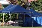 A tent covers the site where a body was found in Kuirau Park, Rotorua this morning. Photo / Daily Post