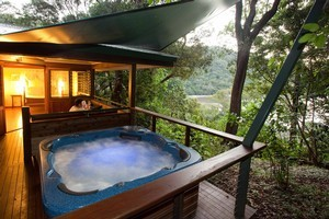 The spa at Queensland's Bloomfield Lodge beckons. Photo / Supplied