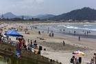 Holidaymakers flock to the beach at Whangamata on a hot and sunny afternoon. Photo / Derek Flynn