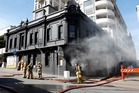 Smoke billows from the ground floor of the Backbencher pub in Wellington after a fire sparked by workmen with a welder. Photo / Mark Mitchell