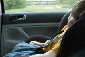 The age at which a child must remain in an approved restraint while travelling in a car will be raised to seven, the government has announced. Photo / Thinkstock