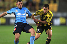 Mitchell Mallia of Sydney FC (L) and Louis Fenton of the Phoenix (R) tackle for the ball during the round one A-League match between the Wellington Phoenix and Sydney FC. Photo / Phil Walter