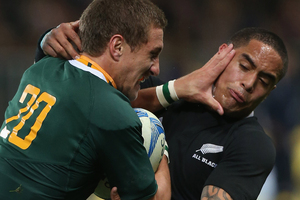 Johan Goosen of South Africa fends off Aaron Smith of the All Blacks during the Rugby Championship. Photo / Getty Images.