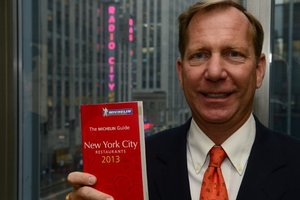 The new International Director of Michelin Guides, Michael Ellis, with the 2013 New York edition. Photo / AFP