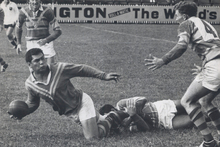 Hard-as-nails Marist forward Oscar Danielson, often touted as the first Polynesian to play first-grade league, looks to offload in a match against Mt Albert at Carlaw Park in 1966. Photo / Supplied